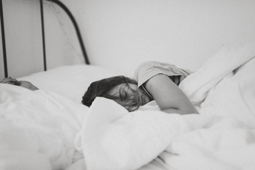 woman asleep in a bed